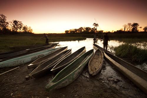 africa travel sunset sky water beautiful boats boat african delta botswana mokoro okavango okavangodelta amazingsky