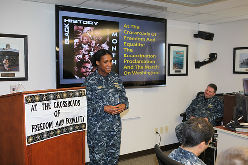 Cdr. Tracy Hines addresses the Expeditionary Strike Group Three (ESG 3) Black History Month observance