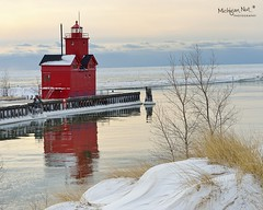 Winter reflections- Holland Harbor Lighthouse (Big Red) by Michigan Nut