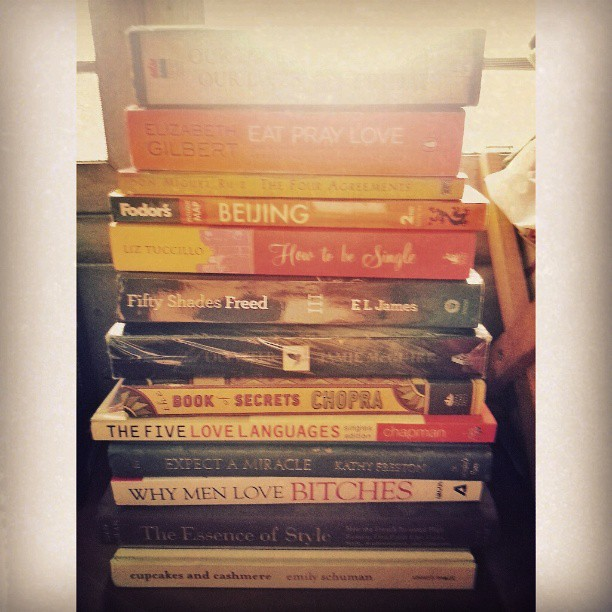 The book stack du juor for reading---a mix of spirituality, psychology, women's studies, young adukt, fashion, travel, and Fifty Shades Freed.  Haha. Very me. #books #homeorganization #iloveboooks #nancyfriday #eatpraylove #beautifuldisaster #howtobesingl