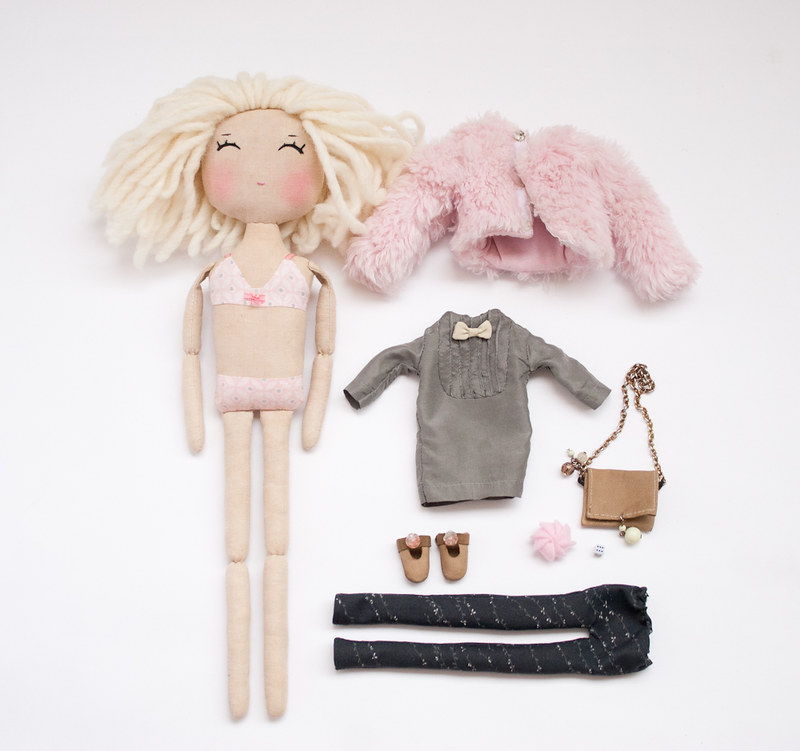 blonde doll and her stuff
