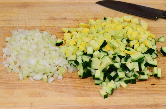 The vegetables chopped up on a cutting board.