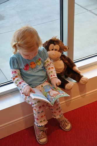 Reading to her Mama Monkey