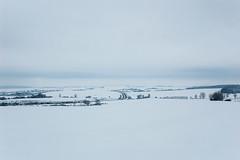 Paysage enneigé, depuis le sommet d'une colline près de Moncheux