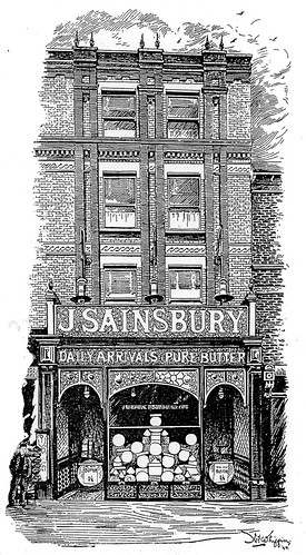 """A black-and-white drawing of a single shopfront in a three-story building. A sign above the ground-floor shopfront reads """"J. Sainsbury / Daily Arrivals Pure Butter""""."""