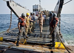 Members of the Royal Thai Navy disembark a landing craft utility and enter the well deck of amphibious dock landing ship USS Tortuga (LSD 46), Feb. 20, during exercise Cobra Gold 2013