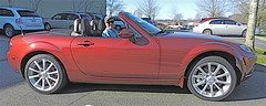 smart roadster(0.0), sports car(0.0), automobile(1.0), automotive exterior(1.0), wheel(1.0), vehicle(1.0), automotive design(1.0), opel gt(1.0), land vehicle(1.0), luxury vehicle(1.0), convertible(1.0),