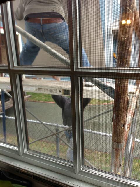 hoisting drywall up scaffolding