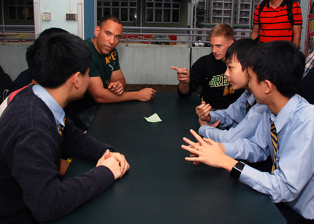 Sailors and Marines assigned to USS Green Bay meet with students from Buddhist Ching Kok Secondary school