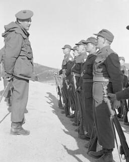 Brigadier Rockingham inspects Corporal Rocky Prentice and other identified men / Le brigadier Rockingham passe en revue le caporal Rocky Prentice et d'autres hommes non identifiés