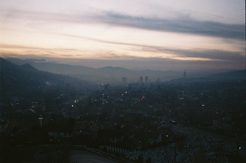 city sunset panorama cemetery graveyard night clouds dark evening twilight haze view dusk sarajevo bosnia hills hazy streaks greys bosna settling