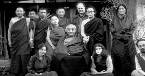 Dilgo Khyentse Rinpoche holding hands with Dagchen  Sakya Rinpoche, Rabjam Rinpoche, Gene Smith, monks, women, photo from documentary on Gene Smith and the preservation of Tibetan books, http://www.lunchboxcity.com/ by Wonderlane