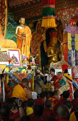 Full mandala offering, monks, lamas, several videographers, statues of the Buddha's students and Sakya Pandita, Sakya Lamdre, Tharlam Monastery of Tibetan Buddhism, Boudha, Kathmandu, Nepal by Wonderlane