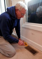 Rick Nipper Measuring Temperature at Floor Vent
