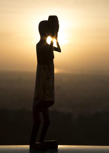 wood statue sunrise worship asia mask malaysia borneo cebu mactan labuan