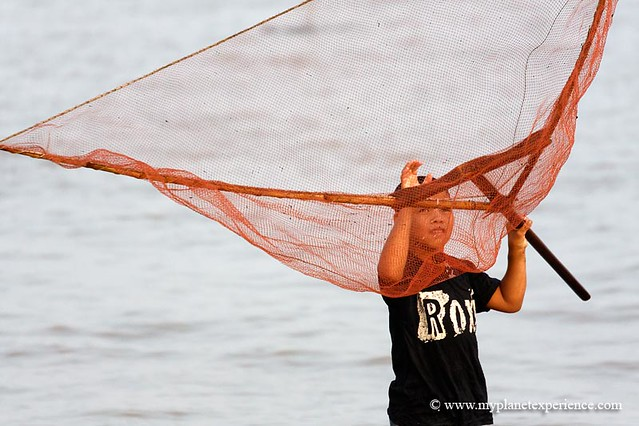 A young fisherman - Tonle Sap Lake, Cambodia