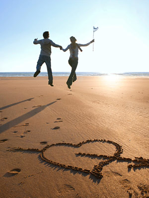 couple-on-beach-heart-in-sand-1-1109-mdn