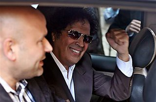 Ahmed Qaddaf al-Dam, cousin of Libya's former revolutionary Pan-African leader Moammar Gadhafi, gestures to supporters from a car after being arrested in Cairo, Egypt, March 19. 2013. by Pan-African News Wire File Photos
