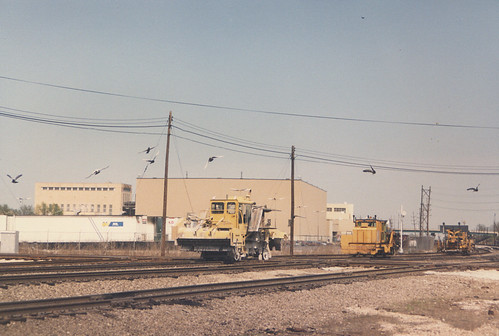 A convoy of track maintenance vehicles pass westbound through Hayford Junction.  Chicago Illinois.  April 1987. by Eddie from Chicago