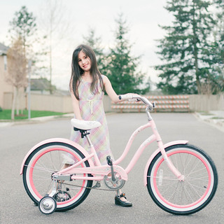 """The Girl With The Coolest Bike In the Neighborhood"""