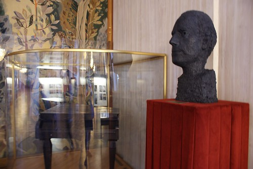 A bust of Mahler and his compact traveling piano... many a composition came to life on this instrument. (Glare unavoidable, pretty sure that's on purpose.)