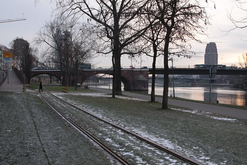 Railway tracks follow the north bank of the river Main