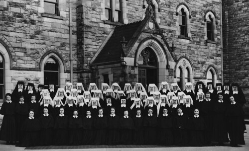 1954-1955. The novitiate in Monaghan, Ireland, with postulants in black bonnets, novices in white veils and junior sisters in black veils.