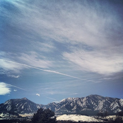 view of the snowy Flatirons from my balcony