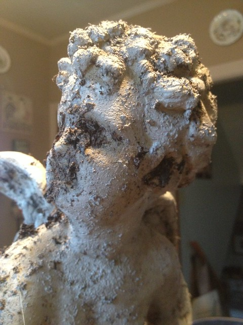 Aging angel with dirt and paint