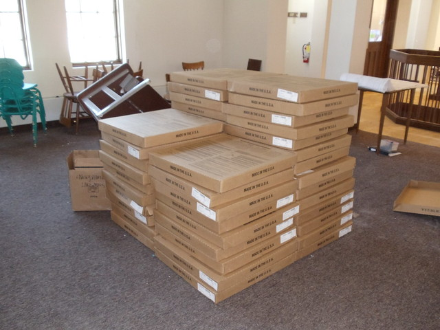 New carpeting for renovation. Boxes of carpet tiles.