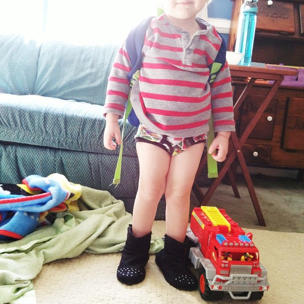 Yesterday's shirt, a backpack, Lego Batman undies, sissy's studded boots on the wrong feet, and his fire truck. AND, of course, he can't go anywhere without his green blankie. #sixcherries #sixcherrieselijahgabriel #elijahsgreenblankie