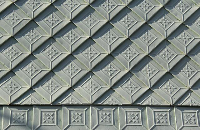 Metal-shingled wall