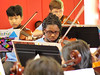 Students in Auburn University's Tiger Strings Orchestra and Loachapoka After School Project outreach program perform together.