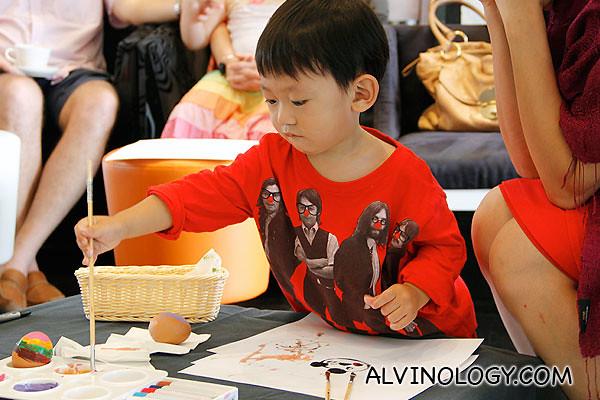 Asher having fun painting