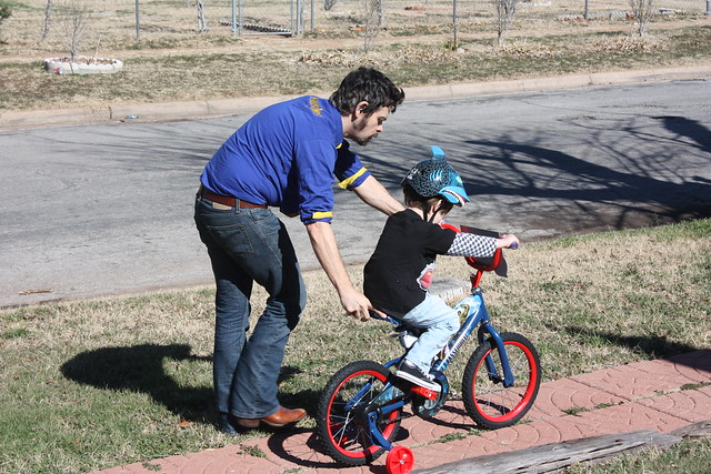 Father and son learning to ride a bike!