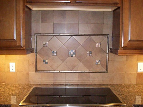Porcelain tile and glass accents backsplash