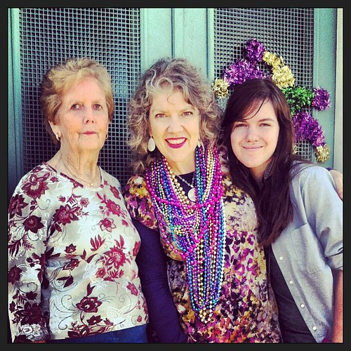 Three generations of strong women. 2-7-13 #neworleans #motheranddaughter #anna #grandmommy #mardigras #smiles #family #aquagreen #purplegoldandgreen #beads #throws #ilovethiswoman #ilovemymama #doors