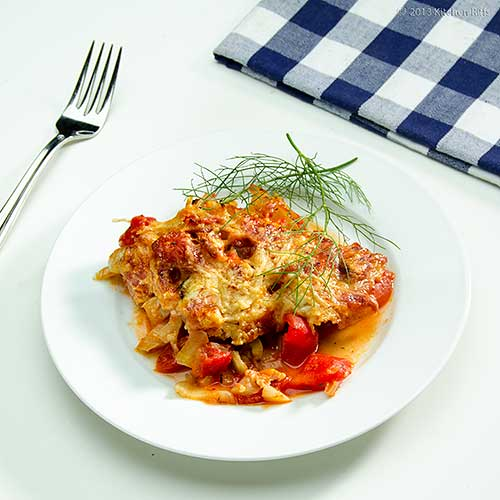 Fennel and Tomato Gratin on plate, with fork and napkin