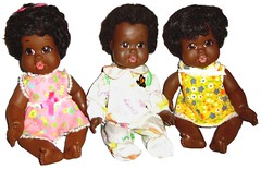 three black baby dolls