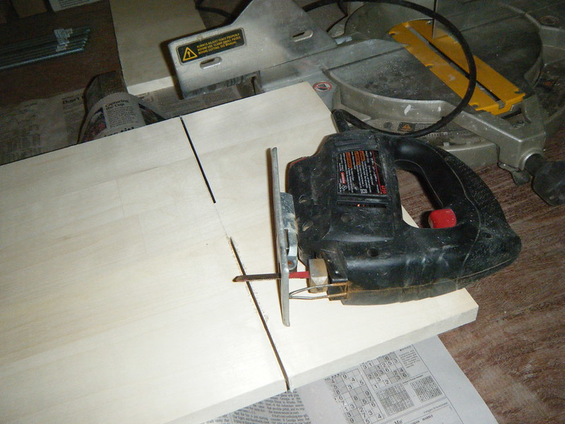 Sawing wood for shelves using jigsaw