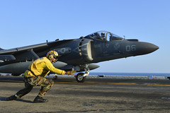 Aviation Boatswain's Mate (Handling) 3rd Class Cesar Salinas launches an AV-8B Harrier jet aircraft from the flight deck aboard USS Bonhomme Richard (LHD 6), March 8. (U.S. Navy photo by Mass Communication Specialist 2nd Class Betsy Knapper)