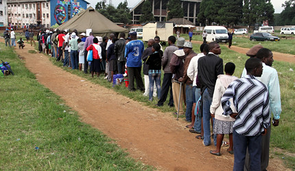 Zimbabweans line up to vote on a new constitution for the Southern African state. The voting went off smoothly and peacefully on March 16, 2013. by Pan-African News Wire File Photos