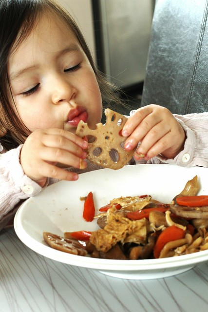 Caya eating Triple Mushroom, Lotus Root, and Soybean Skins