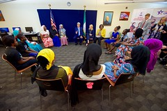 U.S. Secretary of State John Kerry, joined by U.S. Ambassador-at-Large for Global Women's Issues Catherine Russell and Assistant Secretary of State for African Affairs Linda Thomas-Greenfield, meets with a group of young women who have been empowered, or are encouraging others to be empowered, through women's education on August 24, 2016, in the Rosa Parks Room at the U.S. Embassy in Abuja, Nigeria.[State Department Photo/ Public Domain]