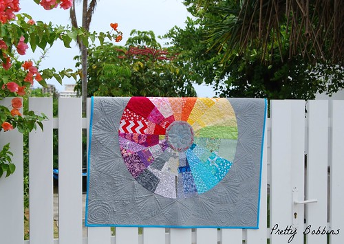 color wheel quilted on fence