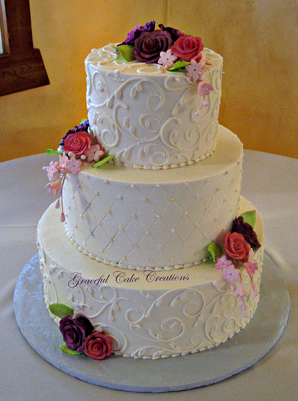 multi colored flowered wedding cakes