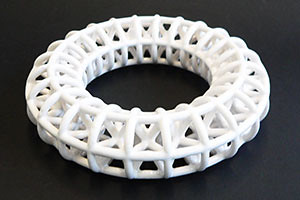 Intricate lattice ceramic circle designed by David Huson and printed using 3D print technology in UWE ceramic material on a ZCorp 510 3D printer