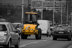 Digger in the traffic jam