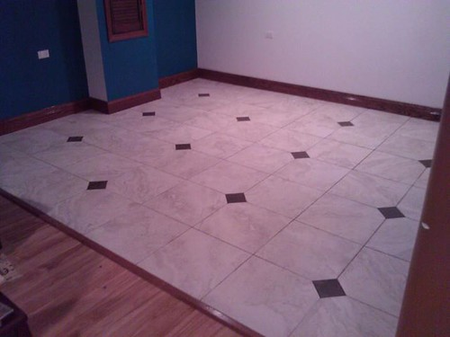Porcelain tile and copper diamond accents