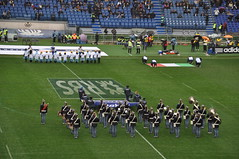 american football(0.0), soccer-specific stadium(0.0), football(0.0), gridiron football(0.0), arena football(0.0), sport venue(1.0), marching band(1.0), musician(1.0), sports(1.0), musical ensemble(1.0), marching(1.0), stadium(1.0), team(1.0),